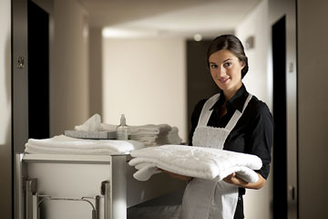 hotel maid doing housekeeping chores